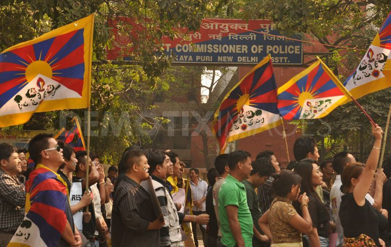 1321981687-tibetan-people-protest-for-freedom-new-delhi_936000