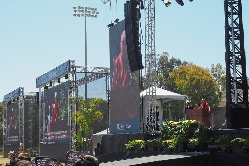 His Holiness the Dalai Lama speaking at University of California San Diego's RIMAC Field in San Diego, CA, USA on June 16, 2017.