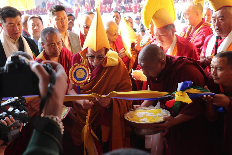 His Holiness doing the ribbon cutting ceremony at the new courtyard