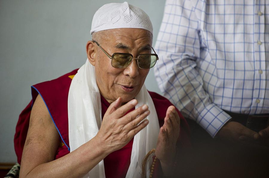 Tibetan spiritual leader the Dalai Lama offers prayer at Hijrat Mosque at the Tibetan settlement in Srinagar, India, on 14 July 2012.