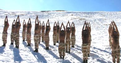 Indo-Tibetan Border Police Practice Yoga in Himalayas