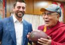 American Footballer Presents Cap, Ball to Dalai Lama