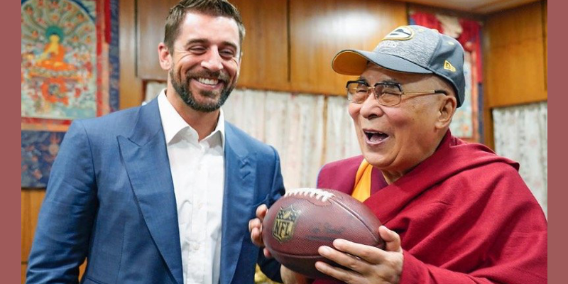 American Footballer Presents Cap, Ball to Dalai Lama