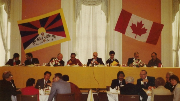Tsering attending a conference that he organized in Canada, sitting in front of His Holiness the 14th Dalai Lama.