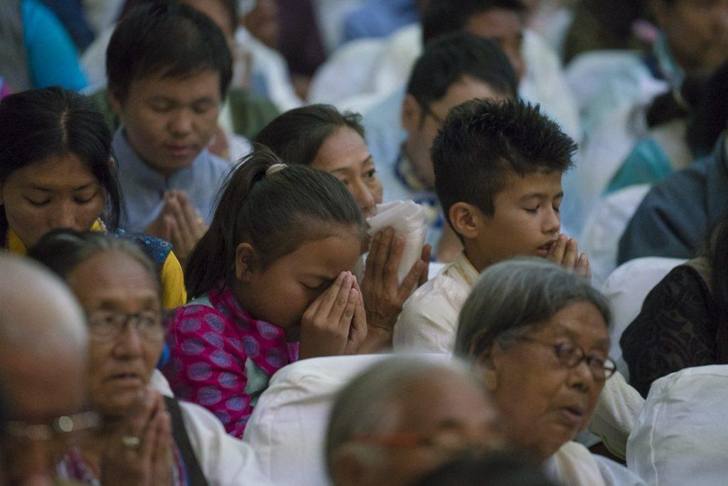 Tibetan community from Phuntsokling settlement listening to His Holiness