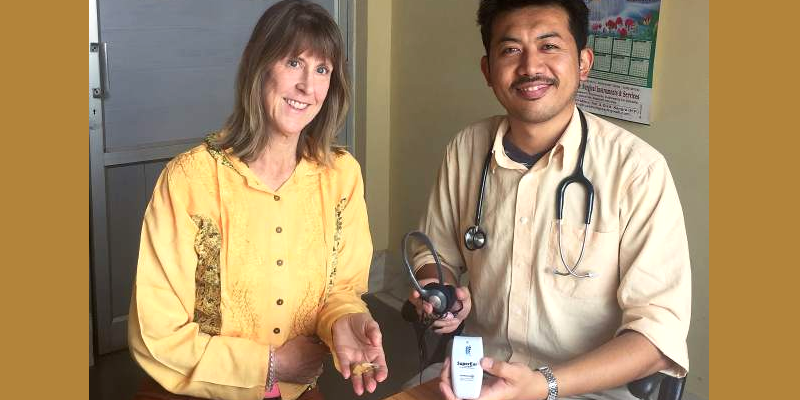 US Pathologist Shares Hearing Aids to Tibetan Refugees