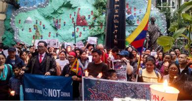 China Warns 8 Years Imprisonment for Tibetans Sharing Hong Kong News